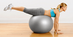Reverse Hip Raise - Lie face-down on a balance ball with your hands flat on the floor. Keeping your legs straight, lift them until your thighs are in line with your torso. Squeeze your glutes as you lift your hips. Pause, then lower to the floor. Do 10 reps, rest, and repeat.