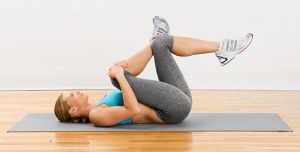 Lying Glute Stretch - Lie face-up on the floor with your knees and hips bent. Place your right ankle across your left thigh. Grab your right knee with both hands and pull it towards your chest. Hold for 30 seconds; switch legs. Do several times a day if you're really tight.