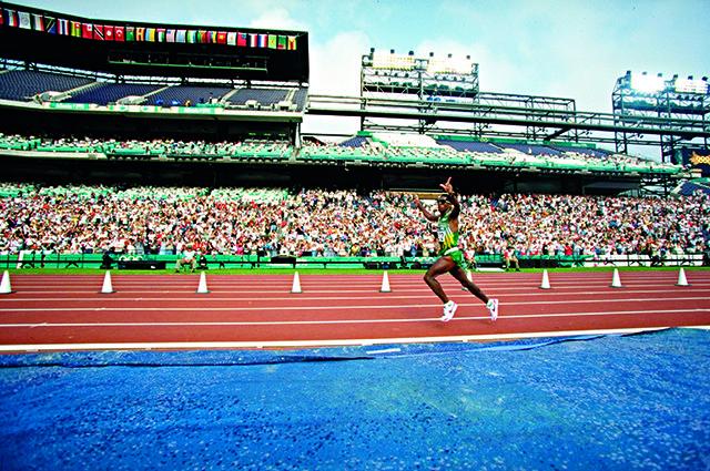 4 Aug 1996: Josia Thugwane of South Africa celebrates as he enters the stadium during the men's marathon at the Centennial Olympic Games in Atlanta, Georgia. Thugwane won gold. Mandatory Credit: Mike Powell /Allsport