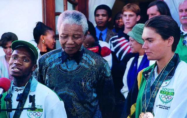 JOHANNESBURG, SOUTH AFRICA - AUGUST 8: (SOUTH AFRICA OUT) Nelson Mandela walks with Olympic stars Josia Thugwane and Penny Heyns (R) on August 8, 1996 in Johannesburg, South Africa. (Photo by Julani van der Westhizen/Sunday Times/Gallo Images/Getty Images)