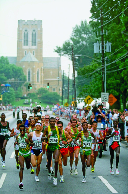 4 Aug 1996: Josia Thugwane of South Africa (no 2122) leads the pack during the men's marathon at the Centennial Olympic Games in Atlanta, Georgia. Thugwane won gold . Mandatory Credit: Gary M Prior/Allsport