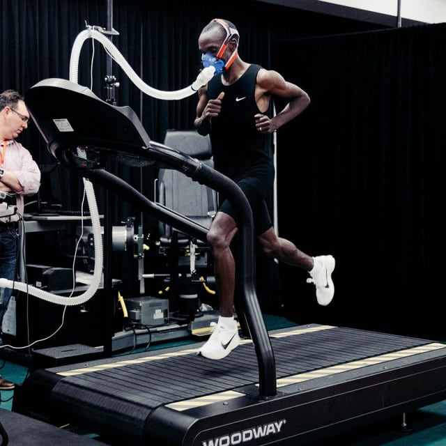 Kipchoge, along with the other runners, did treadmill tests at Nike headquarters earlier this month. The mask he's wearing allows researchers to measure how much oxygen and carbon dioxide he's inhaling and exhaling, enabling them to calculate his maximal aerobic capacity (VO2 max) and how much energy he burns at different running paces. Photograph courtesy of Nike / Clayton Cotterell