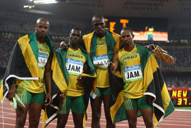 The Jamaican men's team wins the 2008 Olympic 4x100-meter relay, one of Usain Bolt's (second from right) nine gold medals. But Nesta Carter (second from left) has tested positive for a banned substance and the team has now been stripped of its 2008 title. Photo Run