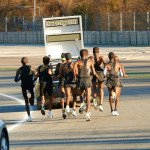 A pace car leads the runners doing a sub-2:00 test half marathon on March 7. Chris Lawrence