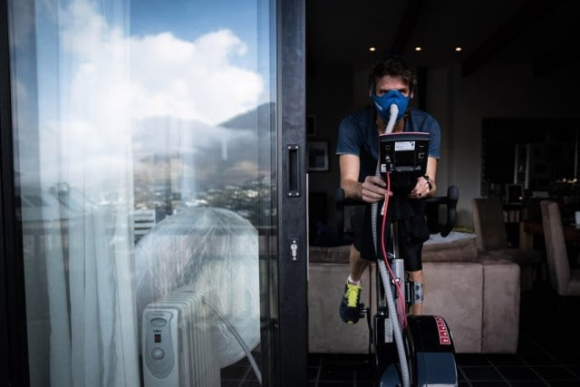 Ryan Sandes on a watt bike with altitude mask © Dean Leslie/ The Wandering Fever