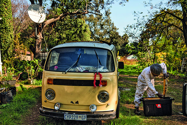 Farai Chinomwe places a beehive in a container beside his broken-down VW Kombi. The Rastafarian beekeeper relocates bees to safer homes if they become a problem in residences. The beekeeper will be running the 87km Comrades Marathon backward to raise awareness for the bees. Picture: Daniel Born
