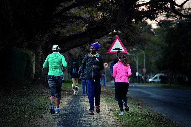 Farai Chinomwe is joined by two women while he trains running backward during one of his last runs before the Comrades Marathon next weekend. Chinomwe began running backward to raise awareness for his plight, to save honey bees. This began after he pushed his car following it breaking down beside the road, he found it easier to push it backward rather than forwards. Picture: Daniel Born