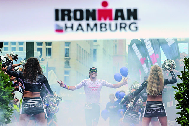 HAMBURG, GERMANY - AUGUST 13:  James Cunnama of South Africa celebrates after winning the IRONMAN Hamburg on August 13, 2017 in Hamburg, Germany.  (Photo by Joern Pollex/Getty Images for IRONMAN)