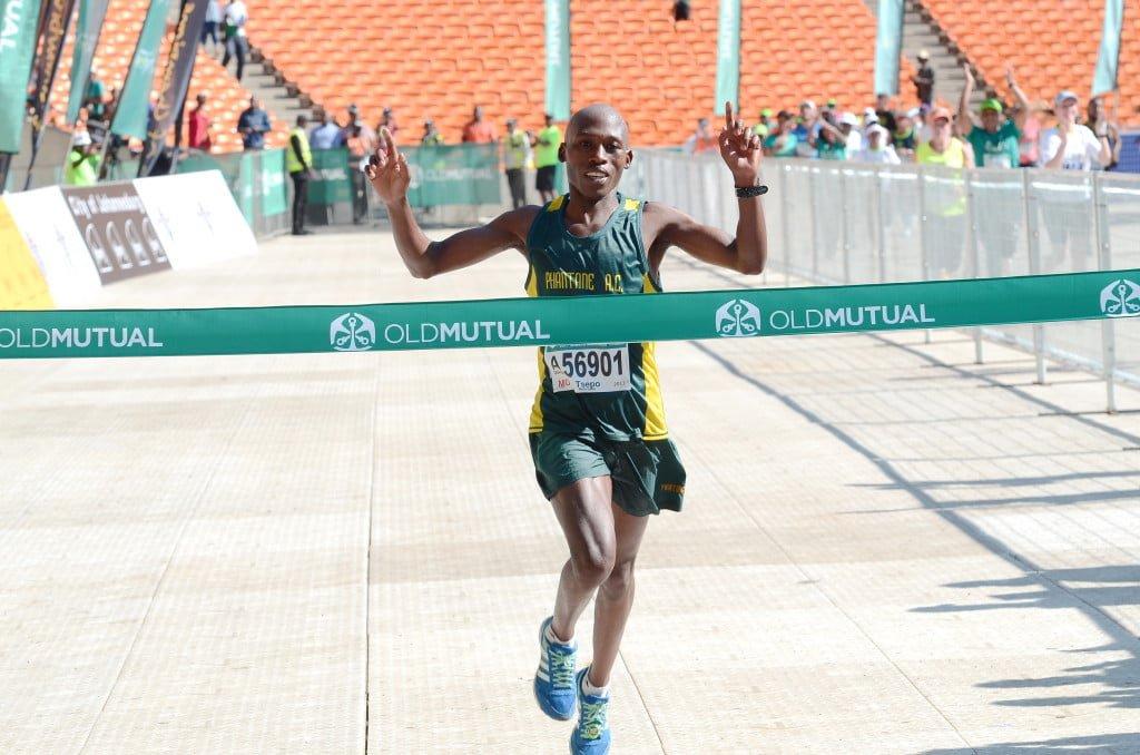 Tsepho Mathibelle takes the win of the 42.2km Soweto Marathon. Photo's courtesy of Jetline Action Photo.