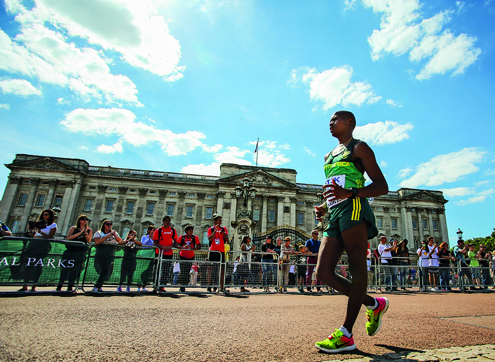 LONDON, ENGLAND - AUGUST 13: Lebogang Shange of South Africa walks past Buckingham Palace during the mens 20km race walk in The Mall in London during day 10 of the 16th IAAF World Athletics Championships 2017 on August 13, 2017 in London, England. (Photo by Roger Sedres/ImageSA/Gallo Images)