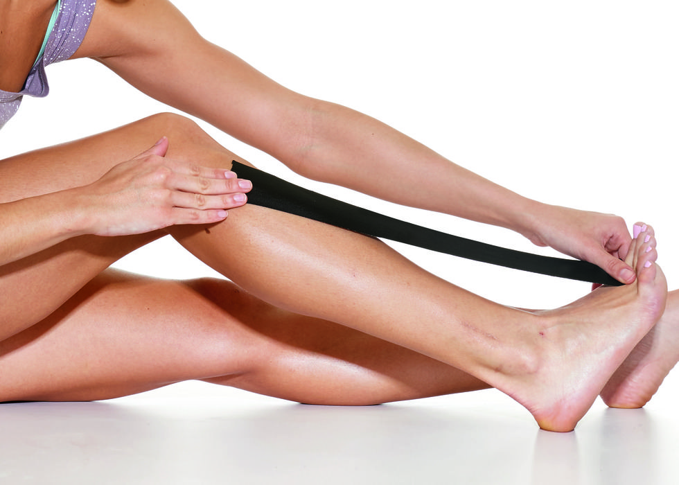 athlete using kt tape for shin splints